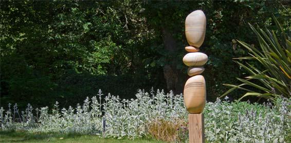 Cairn in garden setting Opener